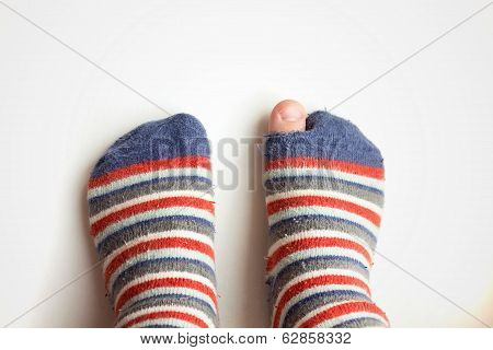 Worn Socks With A Hole And A Finger Sticking Out Of Them