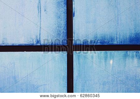 Blue metal wall with wooden partitions