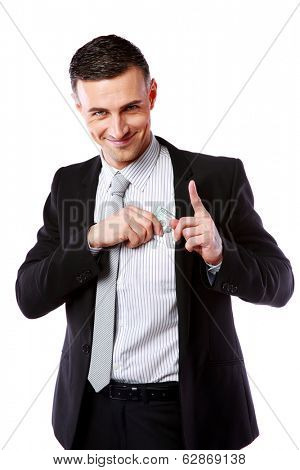 Happy businessman putting money in pocket isolated on white background