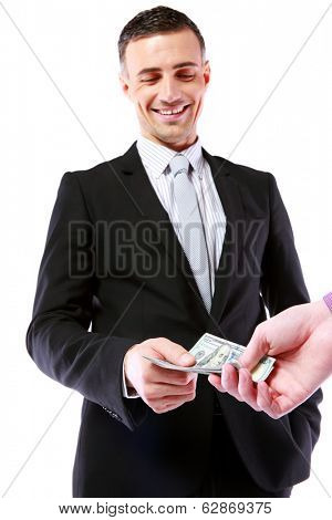 Businessman giving money isolated on white background