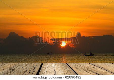 Wooden Floor Facing To Fishing Boat When Sun Rising