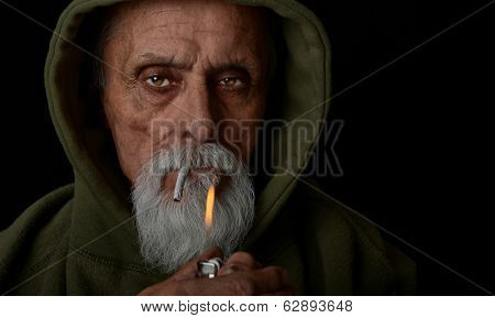 Nice Image of a senior man lighting a marijuana joint