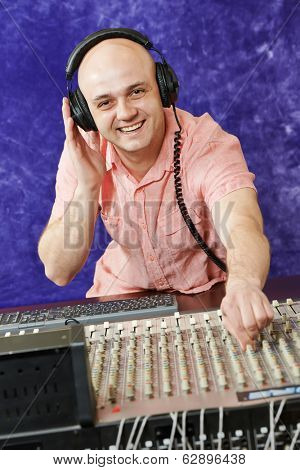 sound engineer work with faders and knobs on professional audio musical mixer
