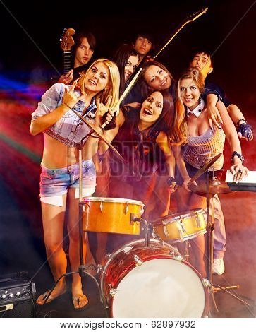 Musical group playing in night club.