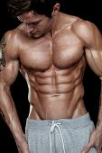stock photo of physique  - Strong Athletic Man Fitness Model Torso showing six pack abs - JPG