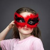 picture of school carnival  - Young girl in carnival mask isolated on grey background - JPG
