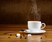 Hot Fresh Coffee In A White Cup With Sugar On Wooden Table