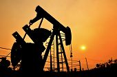 picture of oil derrick  - old pumpjack pumping crude oil from oil well - JPG