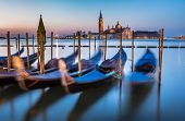 stock photo of gondola  - Gondolas Grand Canal and San Giorgio Maggiore Church at Dawn Venice Italy