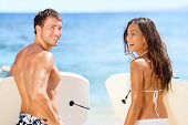 picture of woman bikini  - Surfers on beach having fun in summer - JPG