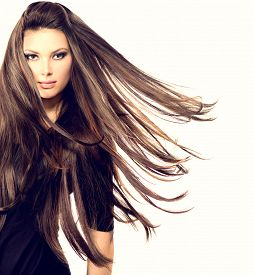 stock photo of hair blowing  - Fashion Model Girl Portrait with Long Blowing Hair - JPG