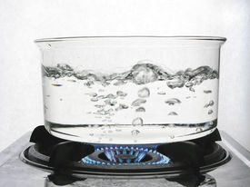 stock photo of boiling water  - Water boiling in glass pan - JPG