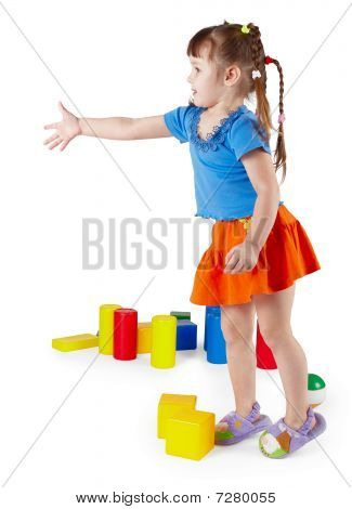 Little Girl In Dress With Toys On White Background