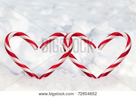 Double Heart Shape Candy Canes In The Snow
