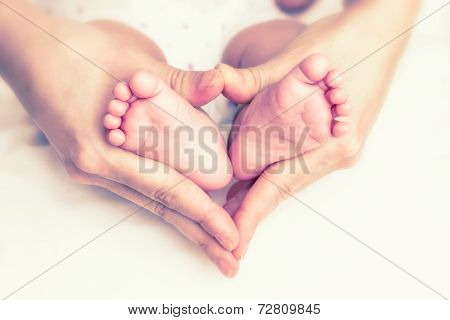 Baby Feet In The Mother Hands
