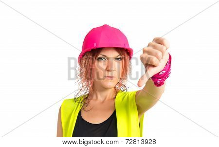 Worker Woman Doing A Bad Signal Over White Background