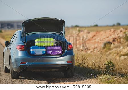 Car loaded with luggage for travel