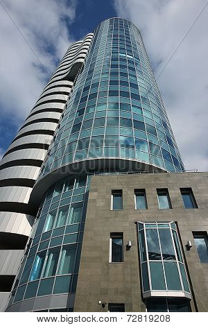 A Bottom View Of The Beautiful Multi-storey Mirrored Building Of Cobra Business Centre On The Backgr