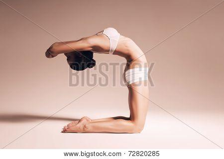 Ballerina Bending Her Back In Warm Room