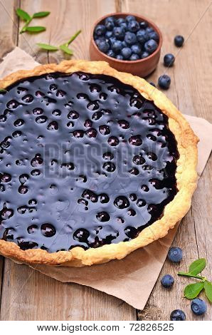 Blueberry Pie And Berries On Wooden Table