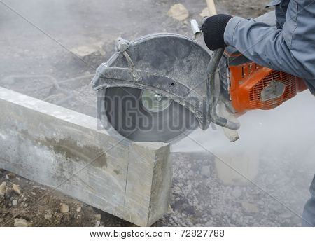 Worker cutting stone block.