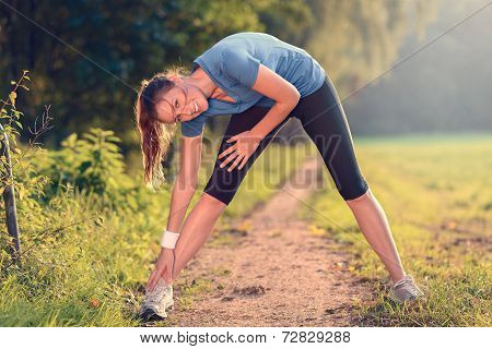 Young Woman Doing Stretching Exercises