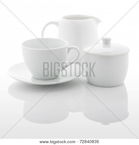 White Milk Jug, Sugar Bowl And Coffee Cup
