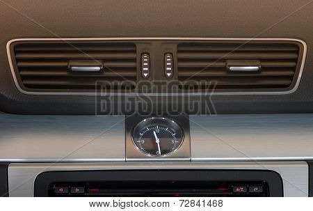 automotive clock and ventilation holes