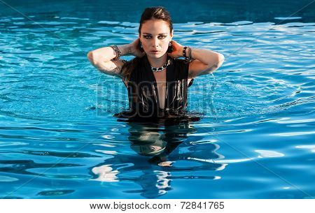 Wet Woman In Black Dress In A Swimming Pool