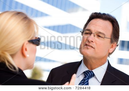 Businessman Talking With Female Colleague