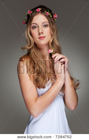 Beautiful Young Woman With Small Flower