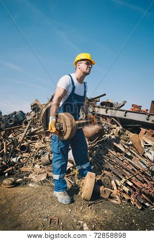 Worker in a junkyard