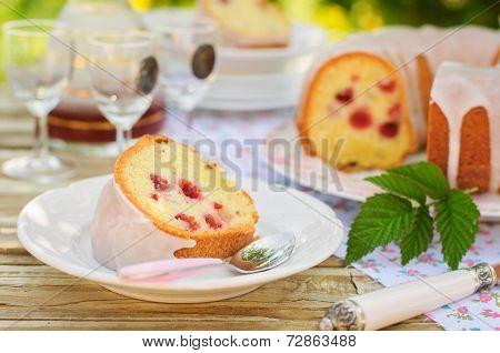 A Slice Of Lemon And Caraway Seed Bundt Cake With Raspberries