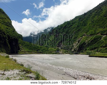 Calm River In The Scenic Mountain Village Tal