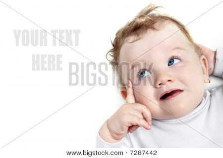 Baby with beautiful blue eyes looking left on something on white background