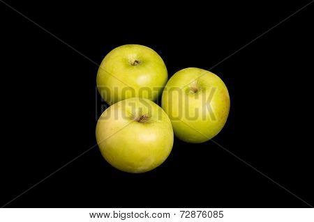 Three Granny Smith Apples On Black Background