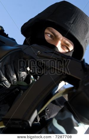 Portrait Of An Armed Soldier In Full Combat Ammunition