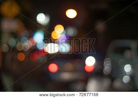 Blur image of street at Kuta, Bali at night with bokeh.
