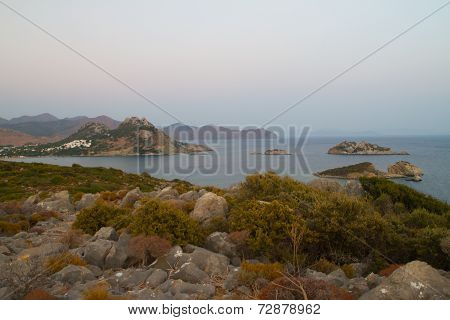 Sunset over sea and mountains i