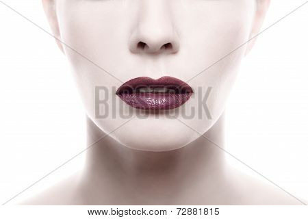 Dark Purple Lipstick On Pale Woman Face