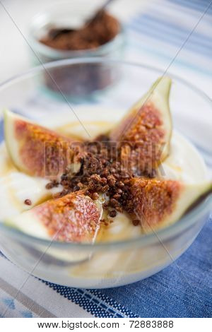 Strained yogurt with sliced figs and honey