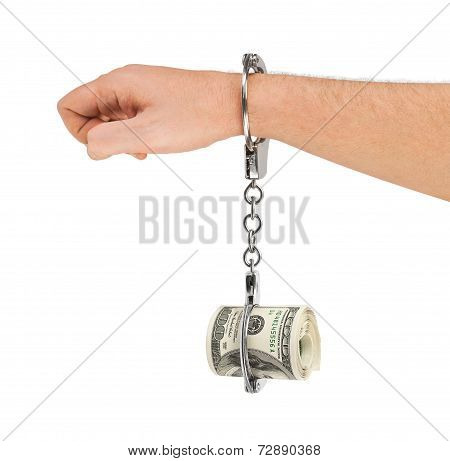 Hand With Handcuffs And Money