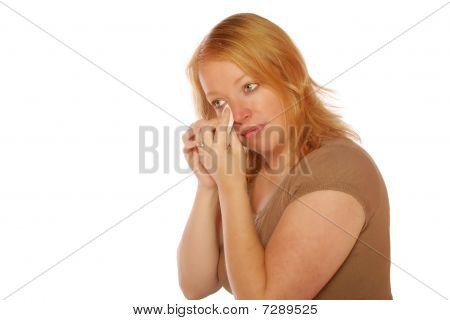 Woman wiping a tear