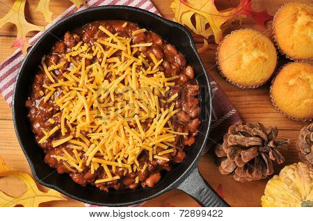 Chili With Cheese In A Cast Iron Skillet