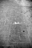 pic of hopscotch  - Hopscotch game drawn out on a road surface with white crayon  - JPG