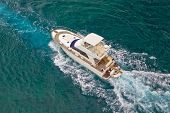 stock photo of yacht  - Yacht sailing on blue sea aerial view - JPG