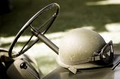image of  jeep  - An US helmet sitting on an old historical jeep - JPG