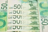 stock photo of shekel  - Stack of Israeli banknotes with fifty shekel note on top - JPG