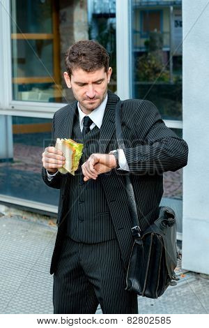 Businessman Is Eating And Looking For Time
