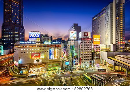 TOKYO, JAPAN - DECEMBER 24, 2012: Shibuya district cityscape at twilight. The district is one of the 23 special wards of Tokyo and known as a center of youth.